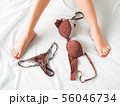 woman leisure female legs red lingerie set bed 56046734