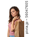 Young caucasian white girl holding paper bag with 56047605