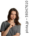 Thinkful young girl with pencil in mouth 56047610