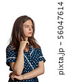 Young girl with dot dress looking suspiciously 56047614
