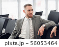 happy businessman discussing with colleague new business plan. 56053464