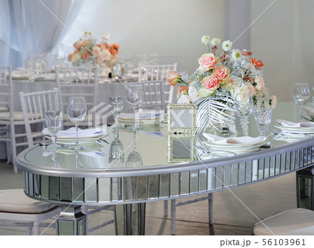 Table served for wedding banquet with roses 56103961
