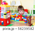 Toddler boy is playing with colorful constructor 56239582