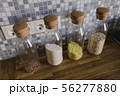 Cereals in banks in the kitchen Glass vessels on the background of a wooden tabletop 56277880