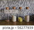 Cereals in banks in the kitchen Glass vessels on the background of a wooden tabletop 56277939