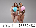 Plus size female models in light underwear smiling to camera 56382488