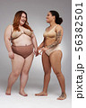 Couple of fat female friends posing for camera 56382501