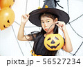 Happy Halloween little witch with a pumpkin 56527234