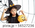 Happy Halloween little witch with a pumpkin 56527236