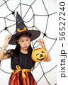 Happy Halloween little witch with a pumpkin 56527240