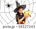 Happy Halloween little witch with a pumpkin 56527243