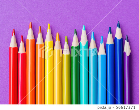 Row of colorful pencils on lilac background 56617371