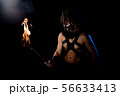 Shirtless male in wolf mask with torch view 56633413