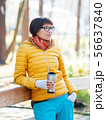 Happy wide smiling women in bright yellow jacketis 56637840