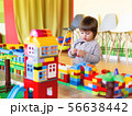 Toddler boy is playing with colorful constructor 56638442