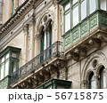 Fragment Of A Building With Windows And Balconies 56715875