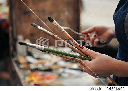 Brushes in the hands of the artist's women. Drawing and art. 56758005