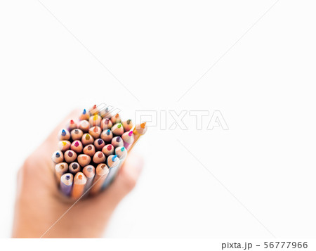 hand with bunch of colorful  pencils on white 56777966