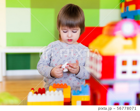 Toddler boy is playing with colorful constructor 56778071