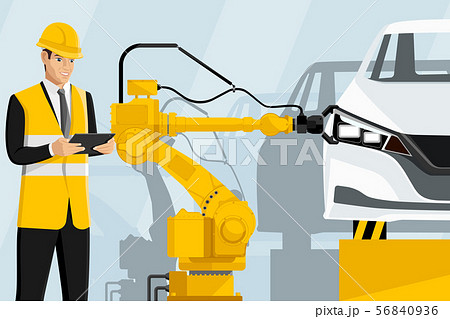 Engineer with a digital tablet controls robots 56840936