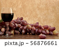 Red wine in glass with grapes 56876661