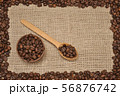 Coffee beans on rag cloth. With frame 56876742