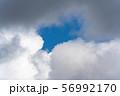 Beautiful clouds floating across sunny blue sky. Stunning cloudscape 56992170