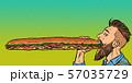 man eats a long sandwich 57035729