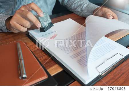 businessman Hand notary public hand ink appoval 57048803