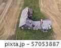Derelict broken abandoned wooden farm house, aerial 57053887