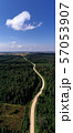 Summer time forest landscape with gravel road, aerial view 57053907