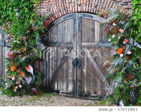 Old wooden doors as traditional arch for wedding ceremony. 57072901