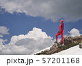 Portrait of hiking woman in red at the beautiful mountains background. 57201168