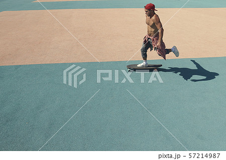 A young man rides a skateboard in a skate Park 57214987