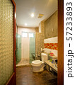 Interior of bathroom with toilet in warm light 57233893
