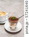 Portion of Classic tiramisu dessert in a glass cup and espresso coffee on concrete background 57241640