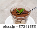 Portion of Classic tiramisu dessert in a glass cup on concrete background 57241655