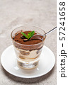 Portion of Classic tiramisu dessert in a glass cup on concrete background 57241658