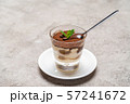 Portion of Classic tiramisu dessert in a glass cup on concrete background 57241672