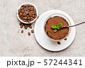 Portion of Classic tiramisu dessert in a glass cup on concrete background 57244341