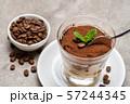 Portion of Classic tiramisu dessert in a glass cup on concrete background 57244345