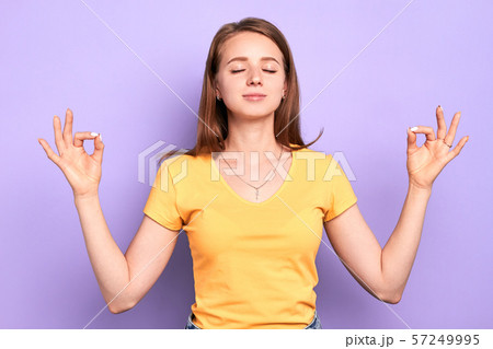 Young beautiful female yoga instructor with peaceful face expression 57249995