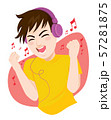 Happy teenager man listening to music and dancing using big headphones 57281875