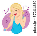 Beautiful young blonde woman listening to music with smartphone device and dancing 57281880