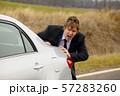 Pushing car 57283260