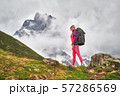 image of hiker with a backpack at the beautiful mountains background. 57286569