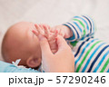 Newborn child holds a mother's finger, close-up 57290246