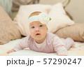 Newborn child wearing a diaper in white sunny 57290247