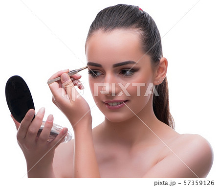 Woman in beauty concept applying make up using cosmetics 57359126