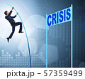 Businessman pole vaulting over crisis in business concept 57359499